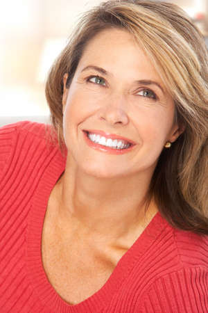 Happy smiling mature woman  at home photo