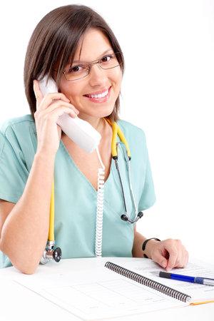 telephone: Smiling medical nurse with telephone. Isolated over white background  Stock Photo