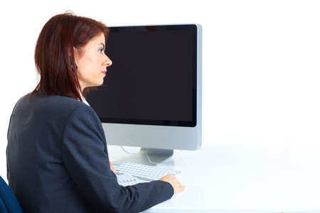 Smiling business woman working with computer. Isolated over white background Stock Photo - 6252879