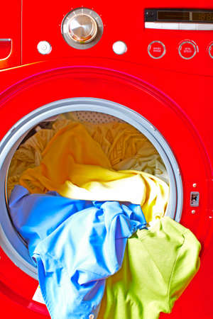 Red washer machine with linen