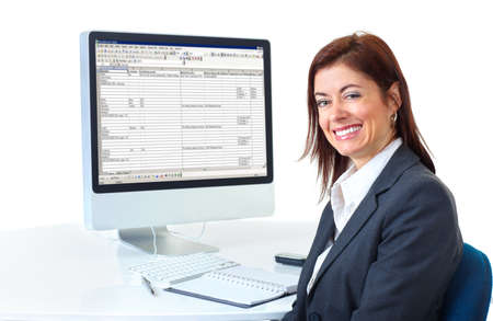 Smiling business woman working with computer. Isolated over white background Stock Photo - 6252888