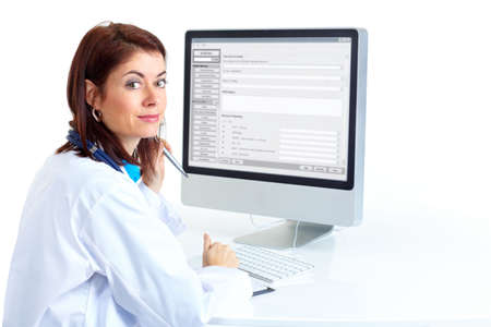 Smiling medical doctor woman with computer. Isolated over white background Stock Photo - 6252900
