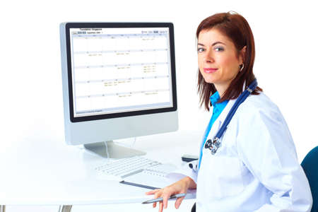 Smiling medical doctor woman with computer. Isolated over white background Stock Photo - 6252881