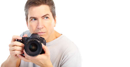 Handsome man with photo camera. Isolated over white background Stock Photo - 6309282