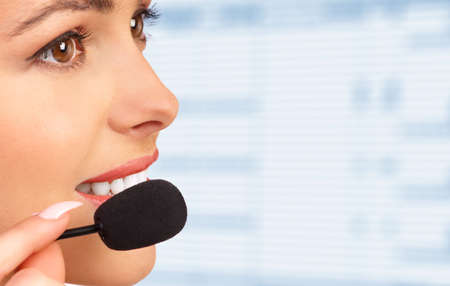 woman on phone: Beautiful  business woman with headset.