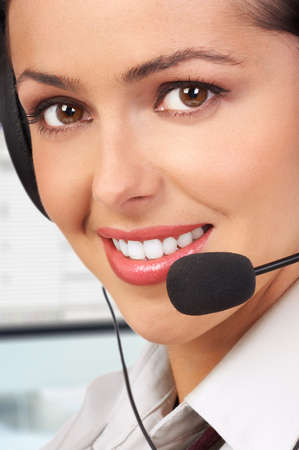 Beautiful  business woman with headset.  photo