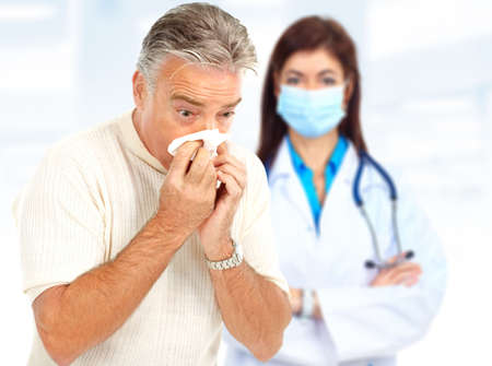 Doctor and man having the flu. Over white background  photo