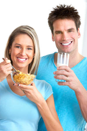Young love couple  drinking milk and eating cereals. Stock Photo - 6352911