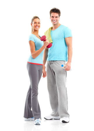 Fitness. Smiling young  strong man and woman. Isolated over white background