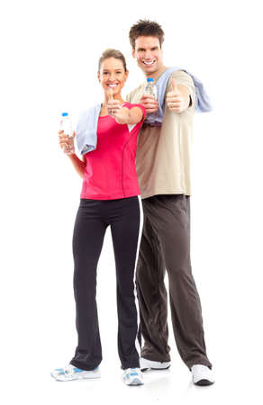Fitness. Smiling young  strong man and woman. Isolated over white background  Stock Photo