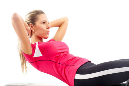 Fitness. Smiling woman working out. Isolated over white background  Stock Photo