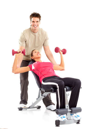 Gym & Fitness. Smiling young woman working out. Isolated over white background  photo