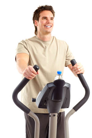 Smiling young strong man working out. Isolated over white background