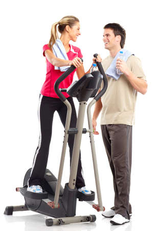 exercitation: Gym & Fitness. Smiling young woman working out. Isolated over white background