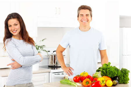 vegetables young couple: Young love couple cooking at the kitchen   Stock Photo