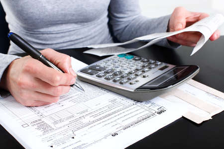 Filling the Form 1040. Standard US Income Tax Return   photo