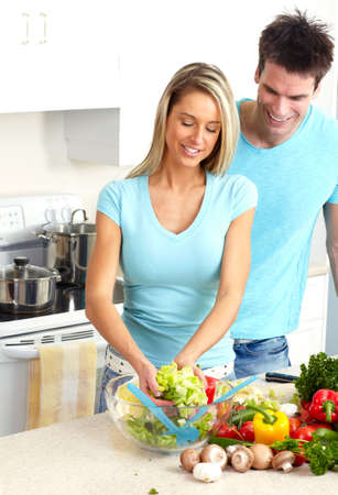 cook house: Young love couple cooking at kitchen
