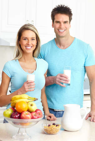 Young love couple  drinking milk at kitchen  photo