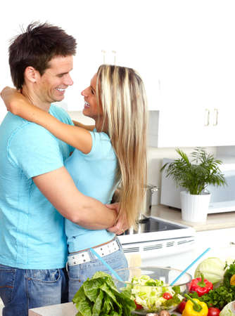 Young love couple at white kitchen photo