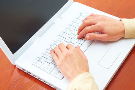 Woman hands and white laptop