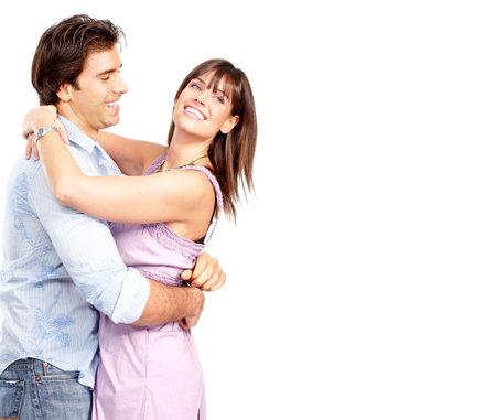 embracing couple: Happy sonriente pareja de enamorados. Sobre fondo blanco  Foto de archivo