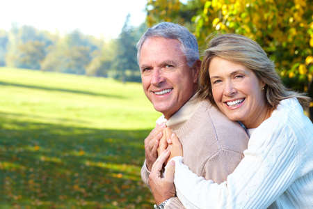 Happy elderly seniors couple in park  photo