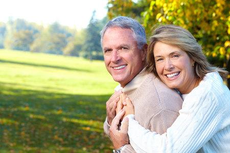 Happy elderly seniors couple in park Stock Photo - 6387381