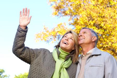 Happy elderly seniors couple in park Stock Photo - 6387336