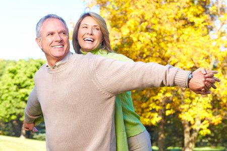 Happy elderly seniors couple in park  版權商用圖片