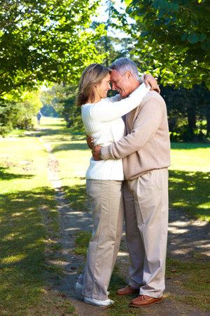 Happy elderly seniors couple in park Stock Photo - 6387383