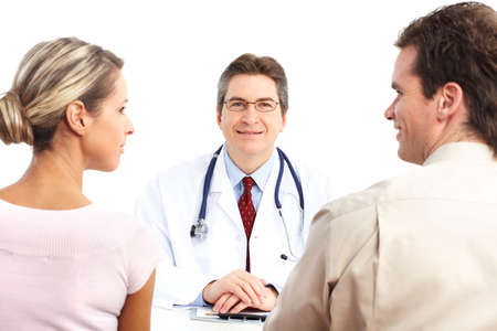 Medical doctor and young couple patients. Isolated over white background Stock Photo - 6387239