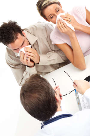 grippe: Doctor and young couple having the flu. Isolated over white background