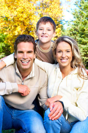Happy family. Father, mother and son in park