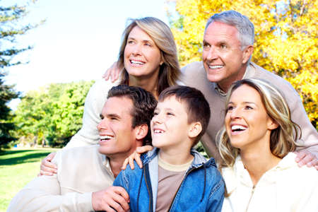Happy family in park. Grandfather, grandmother, father, mother and son Stock Photo - 6387337