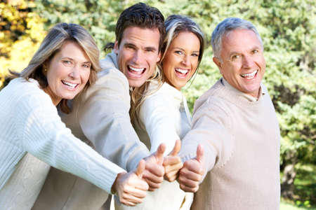 Happy family in park. Father, mother, son and daughter Stock Photo - 6387318