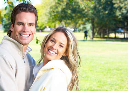 Young love couple smiling in park Stock Photo - 6387317