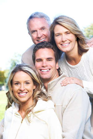 Happy family in park. Father, mother, son and daughter Stock Photo - 6387307