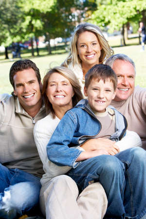 Happy family in park. Grandfather, grandmother, father, mother and son Stock Photo - 6387298