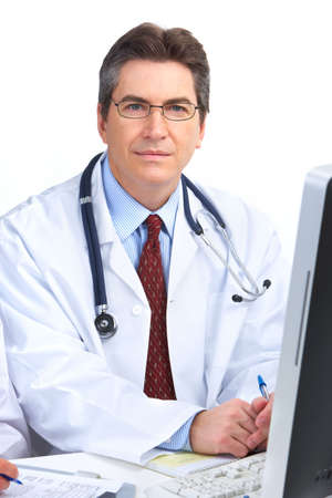 Smiling medical doctor man with computer. Isolated over white background Stock Photo - 6387285