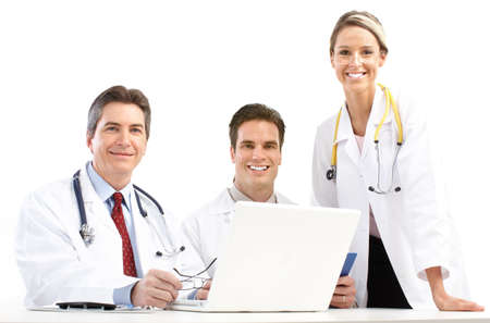 Smiling medical doctors with stethoscopes and laptop. Isolated over white background Stock Photo - 6387291