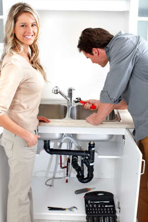 Young plumber fixing a sink Stock Photo - 6407922