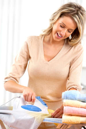 clean  electric: Happy young beautiful woman ironing clothes