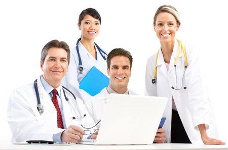 聴診器とコンピューター医師の笑みを浮かべてください。白い背景の上の分離 写真素材