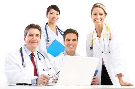 Smiling medical doctors with stethoscopes and computer. Isolated over white background  Фото со стока