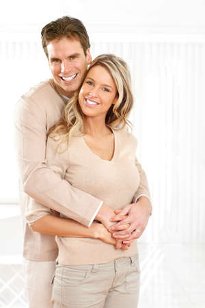 couples hug: Young smiling couple at modern home Stock Photo