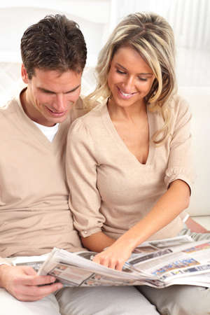 Young love couple reading a magazine  at home Stock Photo - 6423934