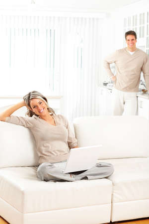 family sofa: Young happy couple in love with laptop at home  Stock Photo