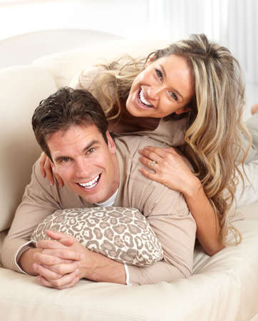 couple on couch: Young happy couple in a bed at home  Stock Photo