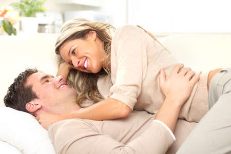 bedroom: Young happy couple in a bed at home  Stock Photo