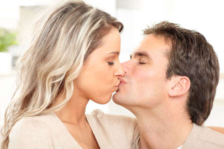 sexy couple kissing: Young happy couple at home